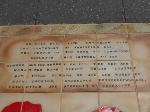 Armistice Centenary upgrade - Close-up of 'On this day' text atop LEST WE FORGET mosaic - with Cenotaph behind - Mosaic Art installation