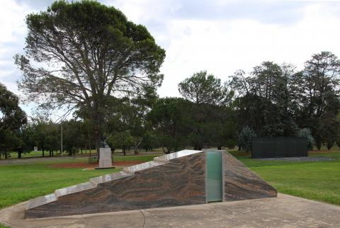 Sandakan Memorial with Lone Pine in the background in the grounds of the Australian War Memorial