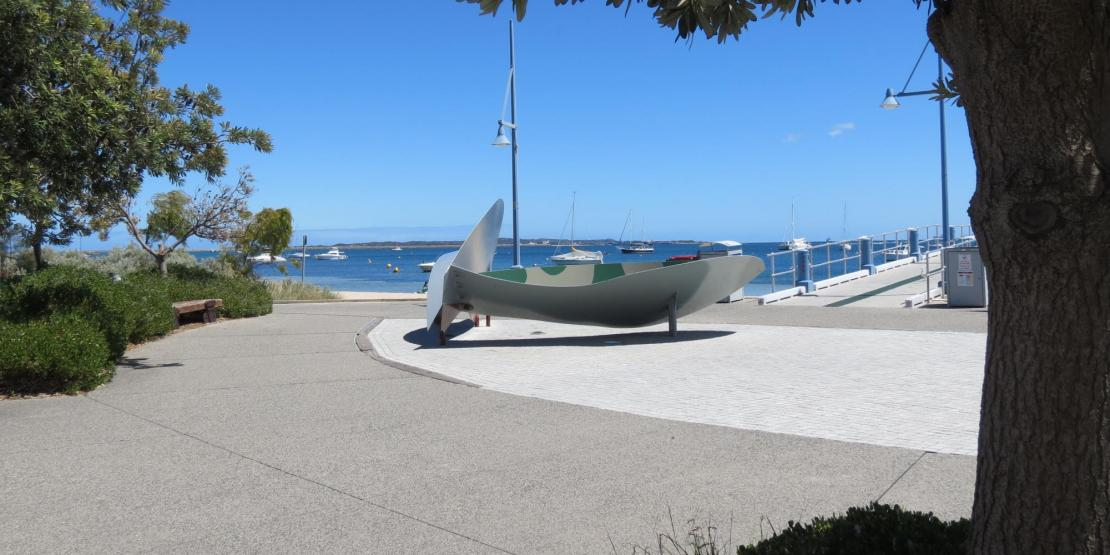 Bench/plaque, stylised propellor and Garden Island naval base in background