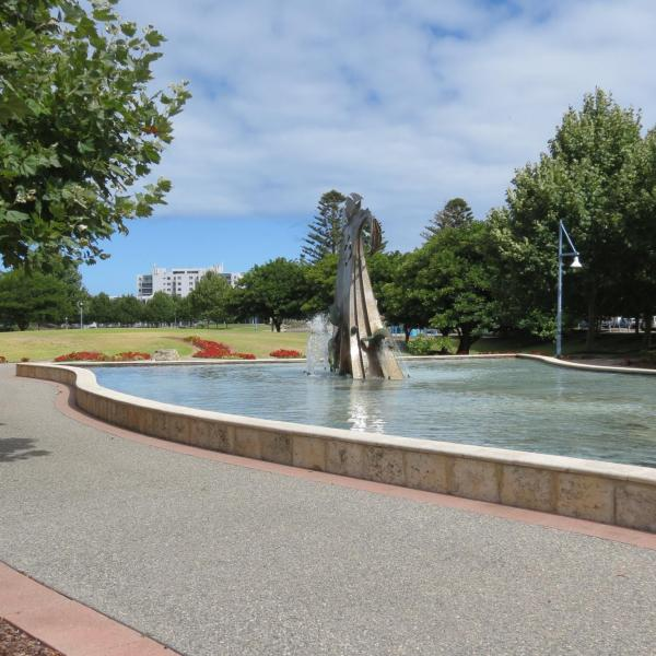 Water feature within Remembrance Flame  - Village Green War Memorial in background