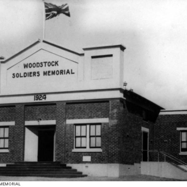 "Memorial hall with flag and the writing ""Woodstock soldiers memorial 1924"""