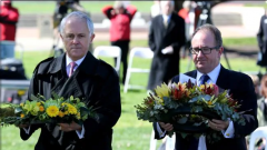 Australian Prime Minister (Malcolm Turnbull MP) and the rep of Opposition Leader (David Feeney MP) lay wreaths at the Dedication of the War Correspondents Memorial on 23 September 2015