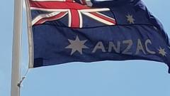 The unique ANZAC flag is still raised at 4:30am each ANZAC Day and Reemembrance Day