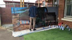 Work begins on painting the Nui Dat mural