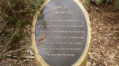 The Coral Sea plaque along the walk