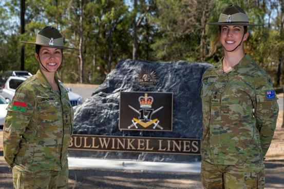 Army Nurses Stand in front Stone Monument that marks the entrance to the 17th Brigade Bullwinkel Lines