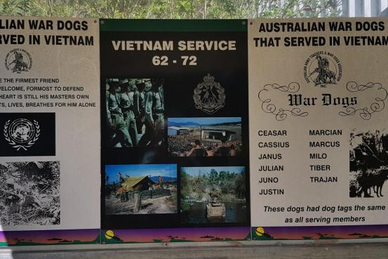 Three panelled sign relating to Vietnam War and Australian War Dogs
