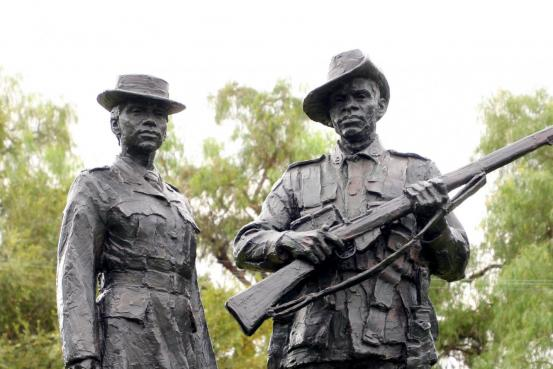 World War I Nurse and World War II Sculptures atop Memorial Base
