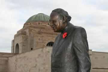 "Sir Edward ""Weary"" Dunlop Bronze Sculpture with Australian War Memorial in the background"