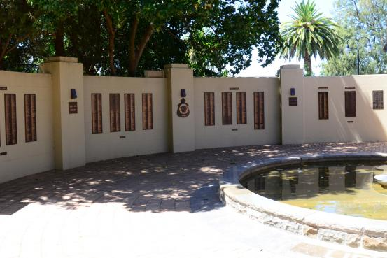 The Honour Roll and Memorial wall surrounds the Eternal Flame