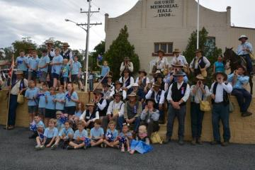 Geurie school children, locals and the ree-enactment volunteers at Geurie Memorial Hal